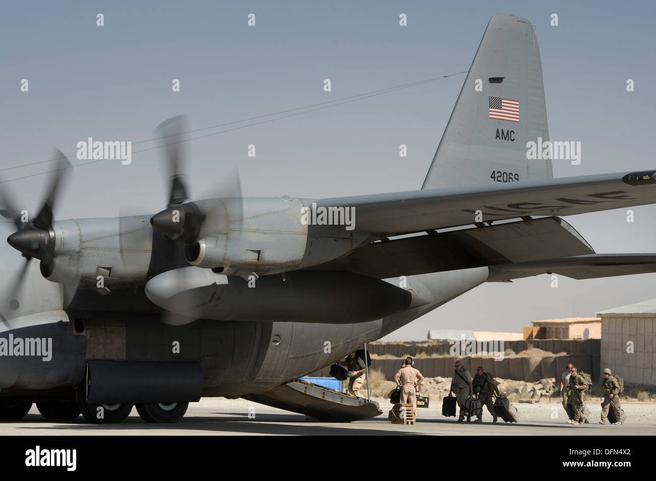 A number of final Department of Defense and military passengers board a 774th Expeditionary Airlift Squadron C-130 Hercules at Forward Operating Base Sharana, Paktika Province, Afghanistan, Sept. 28, 2013. This mission marked a retrograde milestone as the - Stock Image
