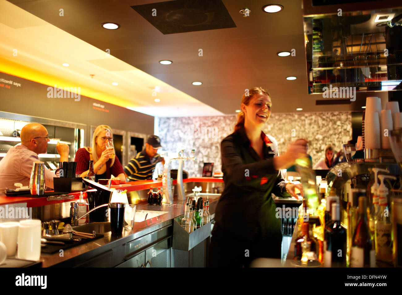 Guests at the bar, canteenM, Citizen M Hotel, Amsterdam, Netherlands - Stock Image