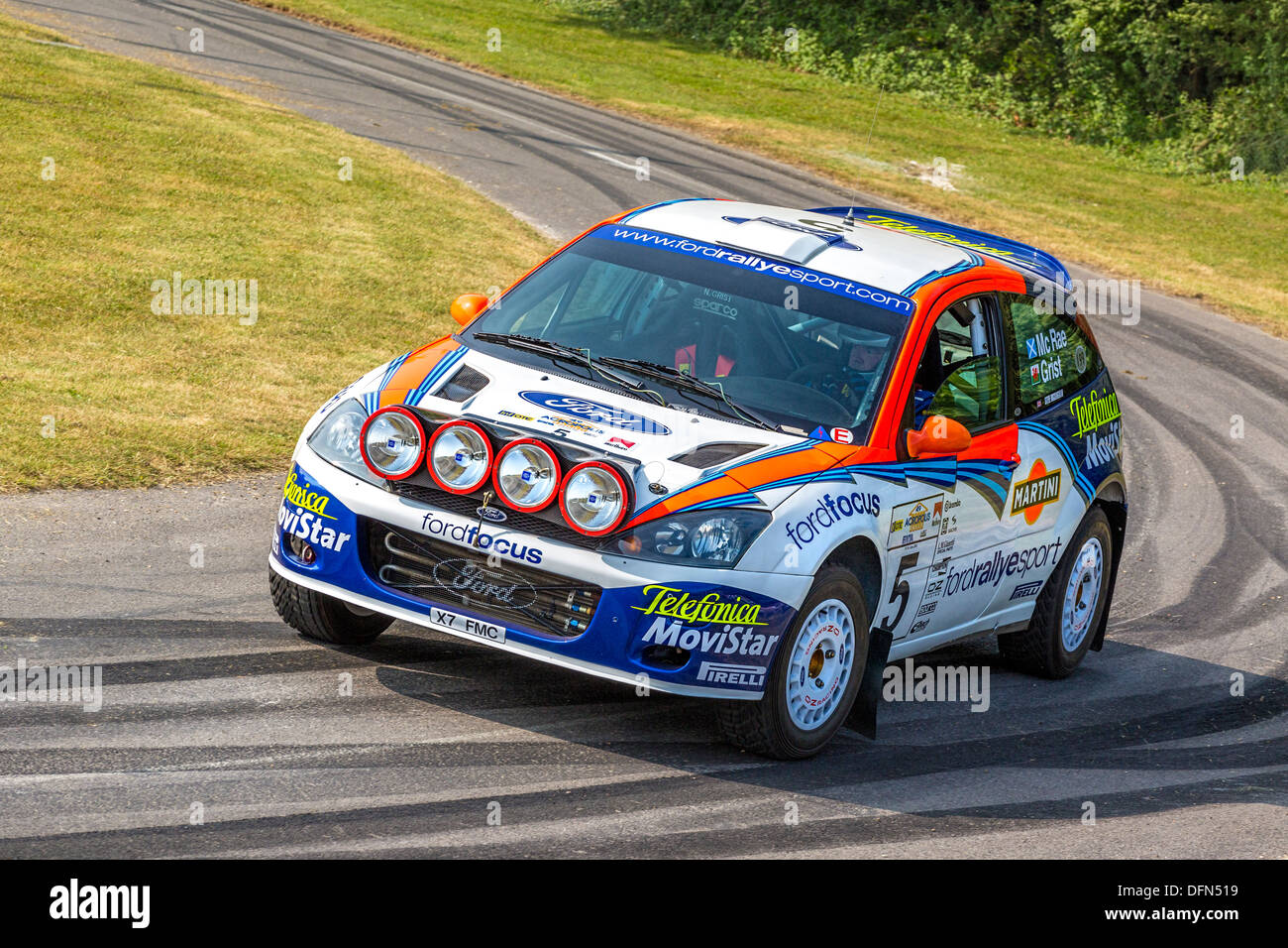 2001 Ford Focus WRC with driver Steve Rockingham on the rally stage at the 2013 Goodwood Festival of Speed, Sussex, - Stock Image