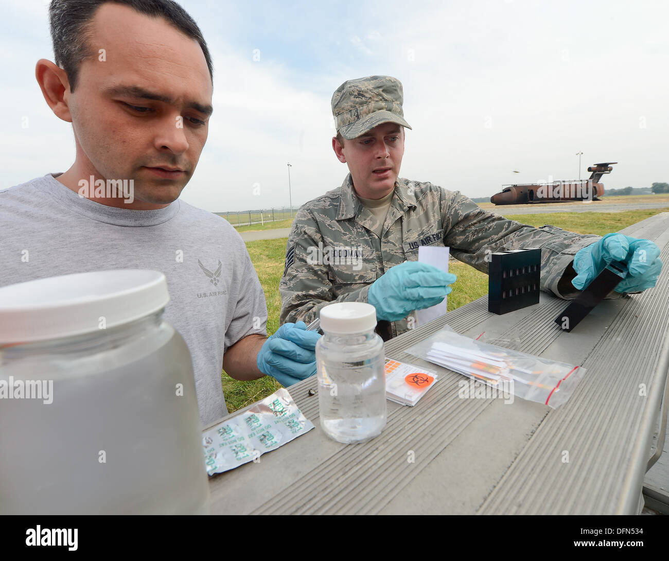 Senior Airman Joseph Davis, (left) 436th Civil Engineer Squadron, Emergency Management Section, and Staff Sgt. Aaron Goodman, 436th Medical Group, Biological-Environmental section, test water for contaminants and purity during a training exercise at Dover - Stock Image