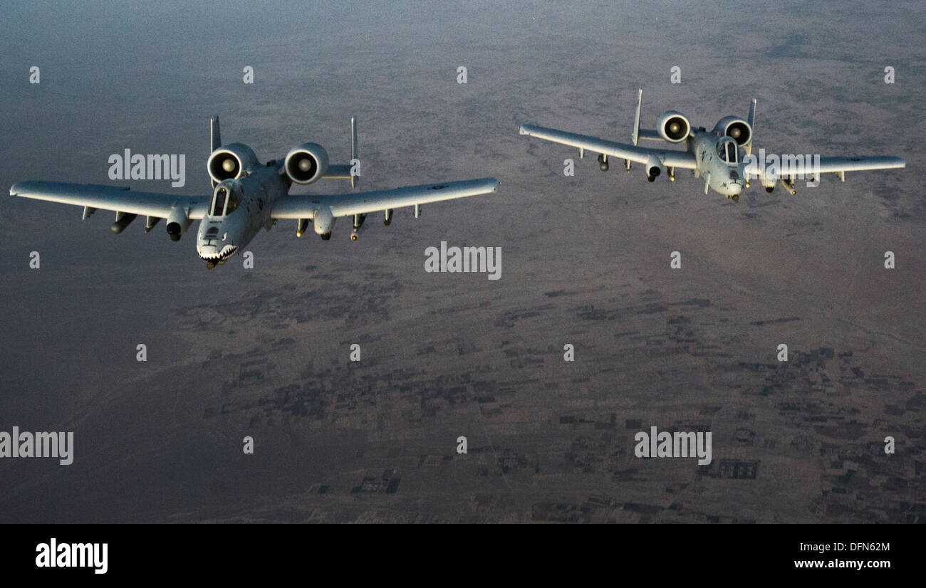 Two U.S. Air Force A-10C Tunderbolt II aircraft prepare to receive fuel from a 340th Expeditionary Air Refueling Squadron KC-135 Stratotanker over Afghanistan Oct. 2, 2013. The A-10s are deployed from Moody Air Force Base, Ga., to the 74th Expeditionary F - Stock Image