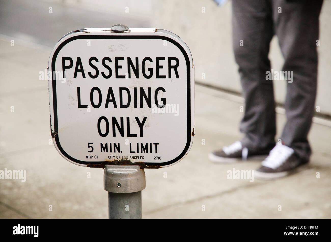 Restricted street area for loading van passengers, Los Angeles, US - Stock Image