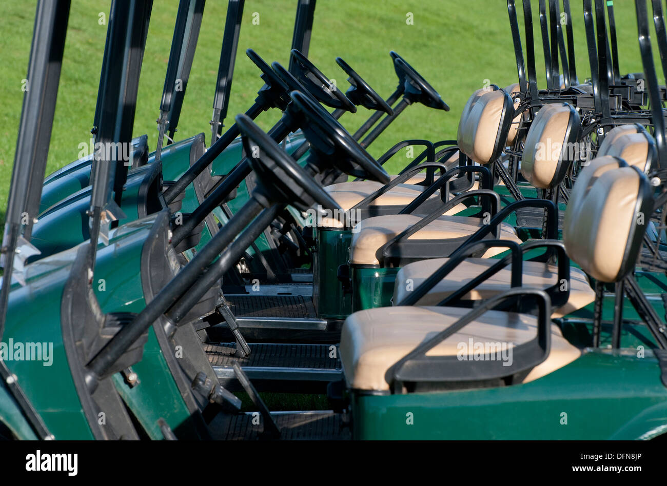 row of parked golf carts - Stock Image