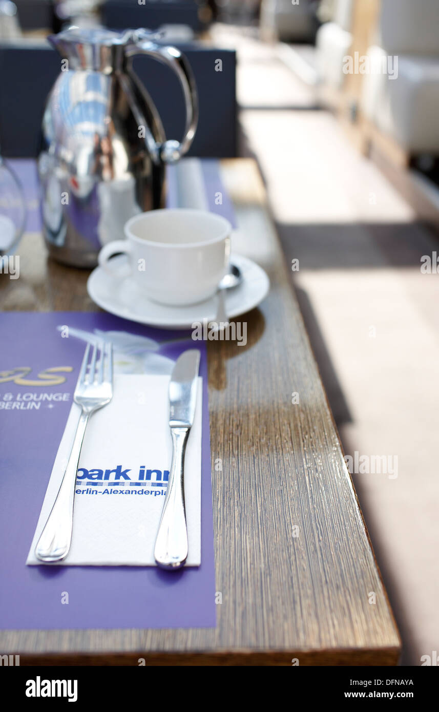 Laid table in Spagos Restaurant and Lounge, Park Inn Hotel, Alexanderplatz, Berlin, Germany - Stock Image