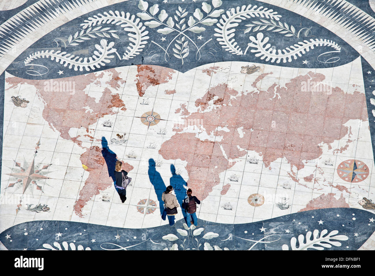Tourists on a giant world map at the foot of the Monument to the Discoveries, Padrao dos Descobrimentos, Belem, Lisbon, - Stock Image