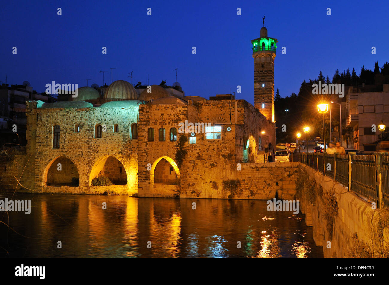 Noria waterwheel on the Orontes River and Nuri, Nouri Mosque in Hama, Syria, Middle East, West Asia Stock Photo