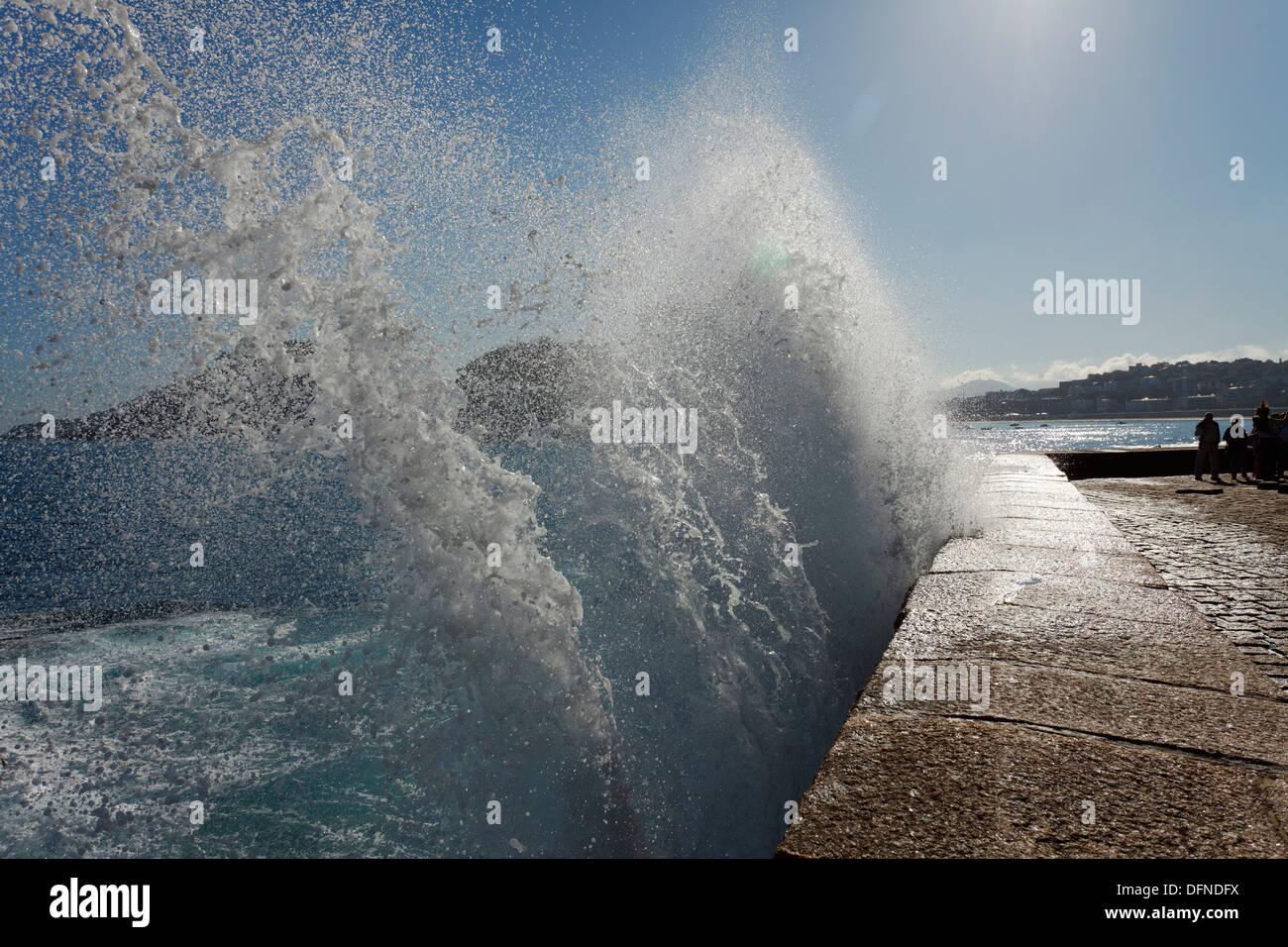 Breaking wave at the seaside promenade, Paseo del Peine del Viento, seafront, San Sebastian, Donostia, Camino de la Costa, Camin - Stock Image