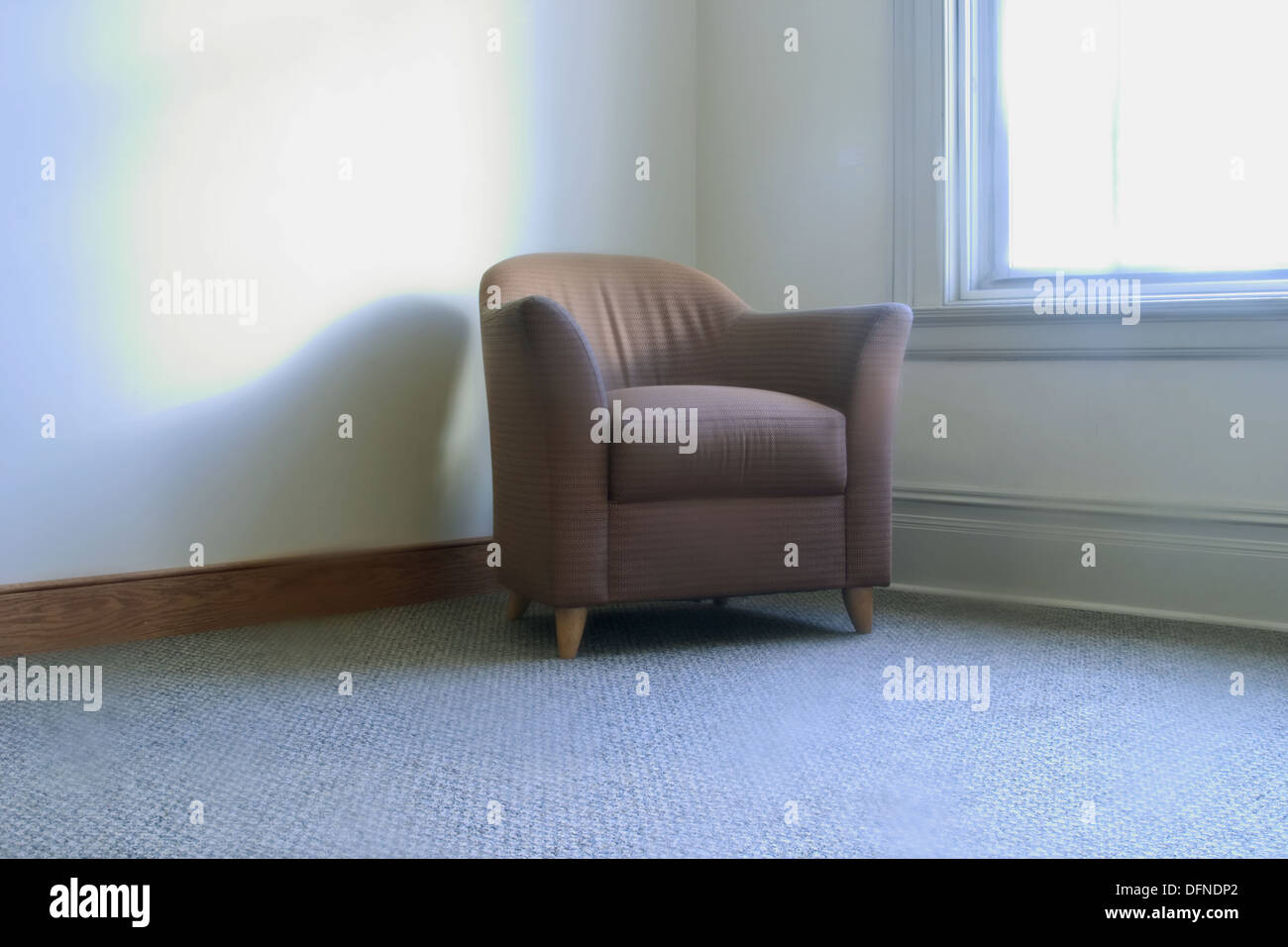 Overstuffed Chair Setting In The Corner By A Window In An Office Building  Hallway.