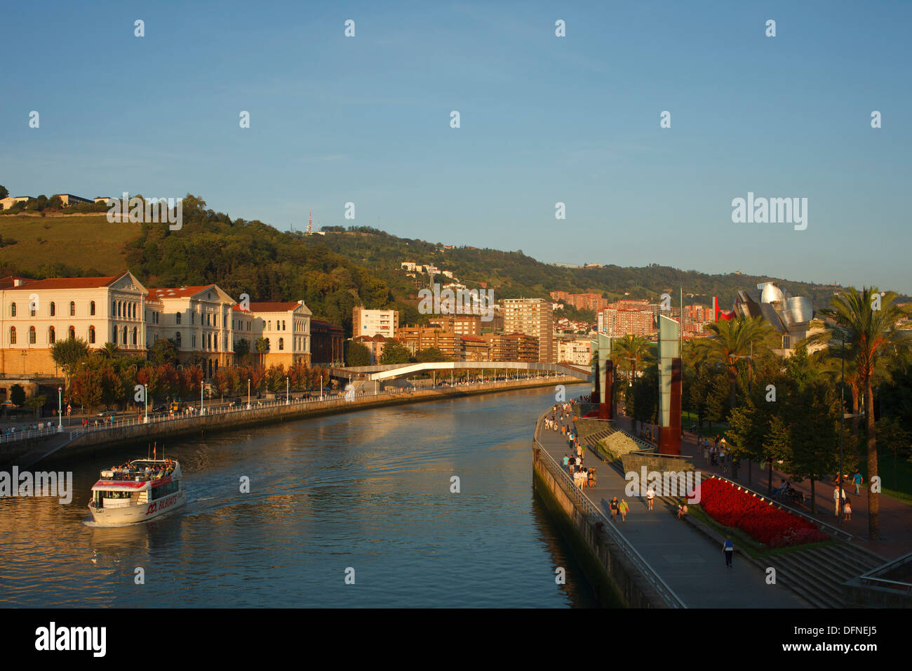 Universidad de Deusto, university at the river Rio Nervion in the evening light, Guggenheim Museum of modern and contemporary ar - Stock Image