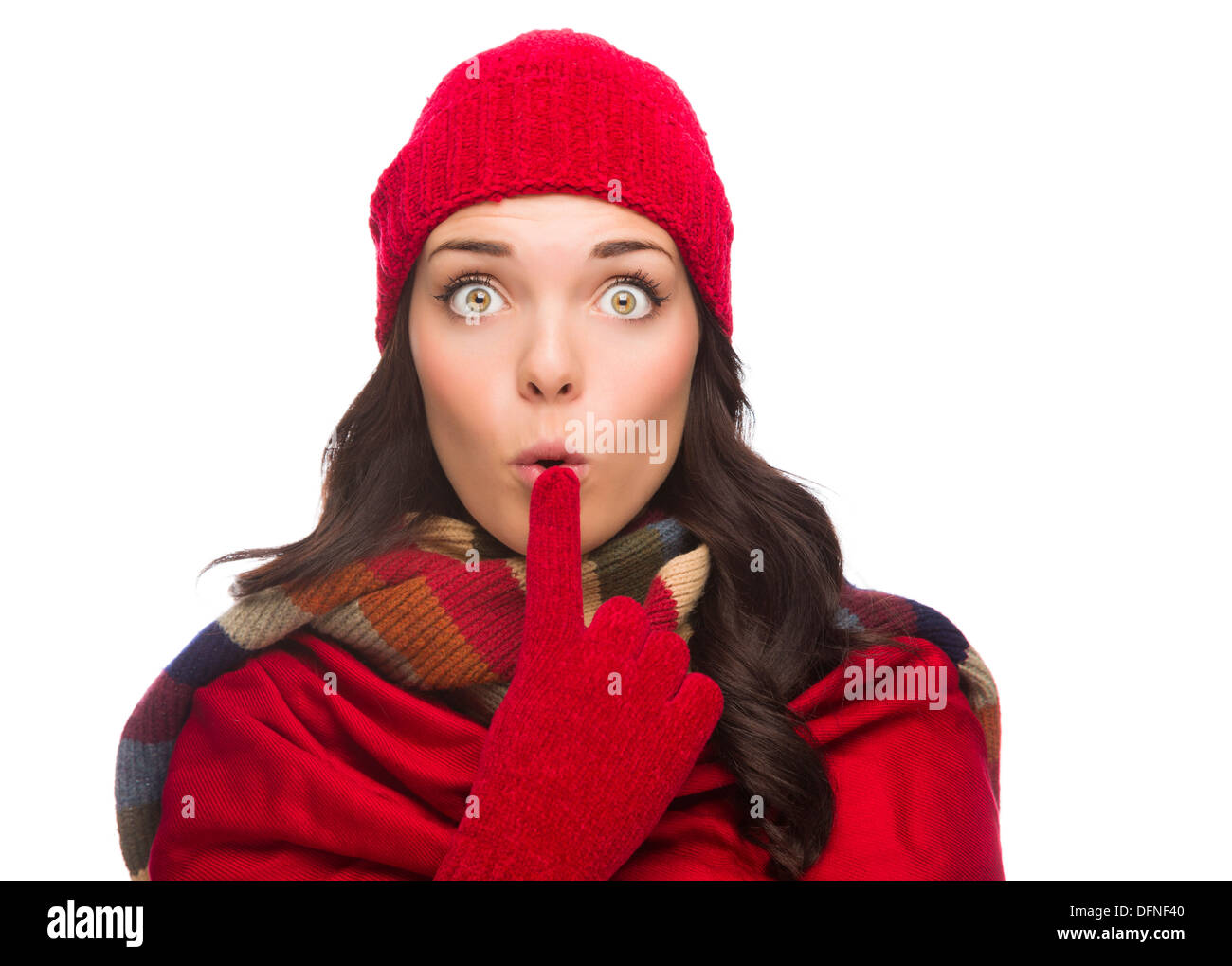Funny Faced Wide Eyed Mixed Race Woman Wearing Winter Hat and Gloves Isolated on White Background. - Stock Image