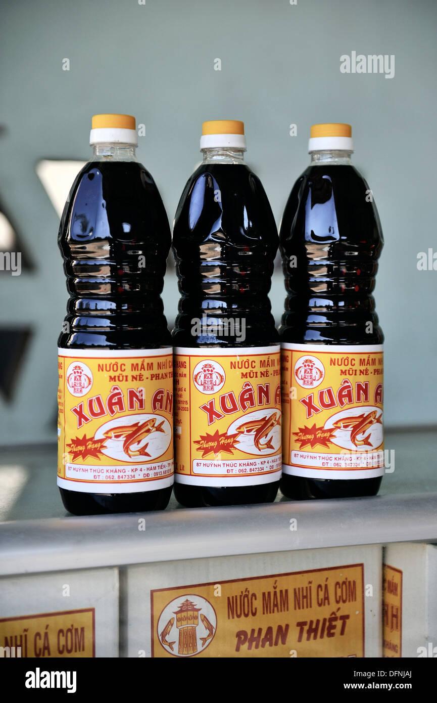 Bottles of vietnamese fish sauce, Mui Ne fishing village, Vietnam Stock Photo