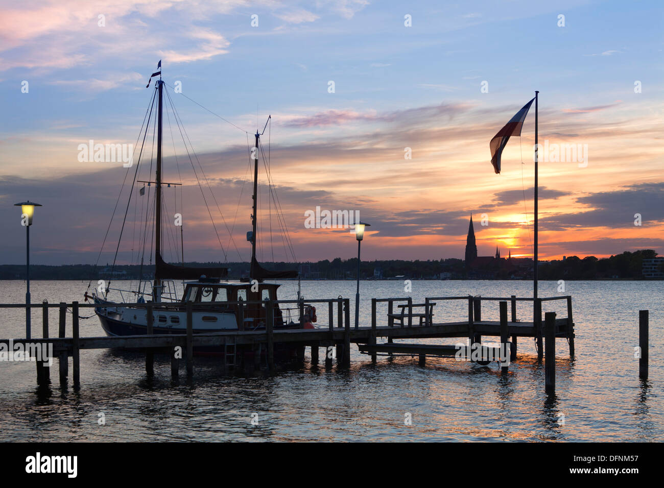 View from a pier onto the cathedral St Petri at sunset, Schleswig, Schlei fjord, Baltic Sea, Schleswig-Holstein, Germany, Europe - Stock Image