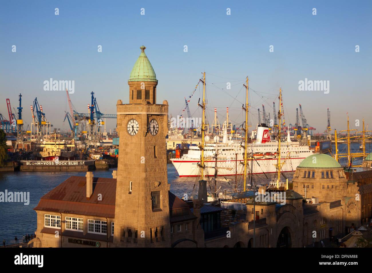 Cruise ship MS Deutschland entering port at the tower of St. Pauli Landungsbruecken, Hamburg, Germany, Europe Stock Photo