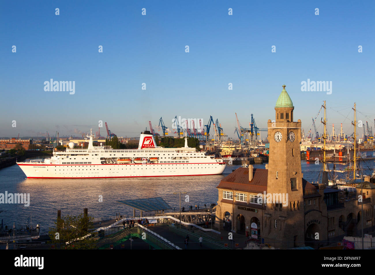 Cruise ship MS Deutschland entering port at the tower of St. Pauli Landungsbruecken, Hamburg, Germany, Europe Stock Photo