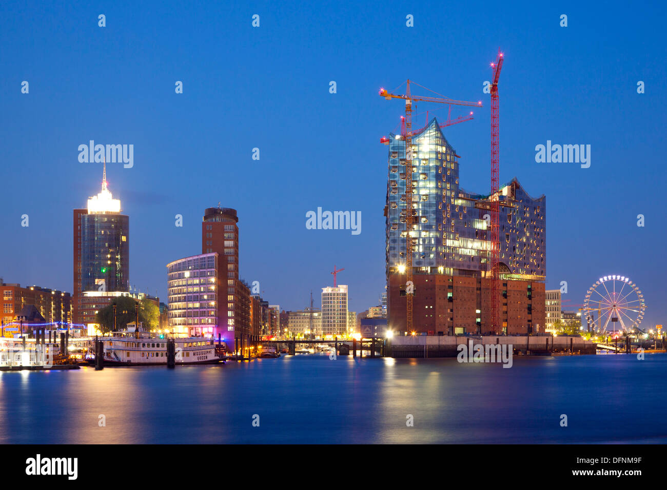 View of Hafen City and Elbphilharmonie at night, Hamburg, Germany, Europe - Stock Image