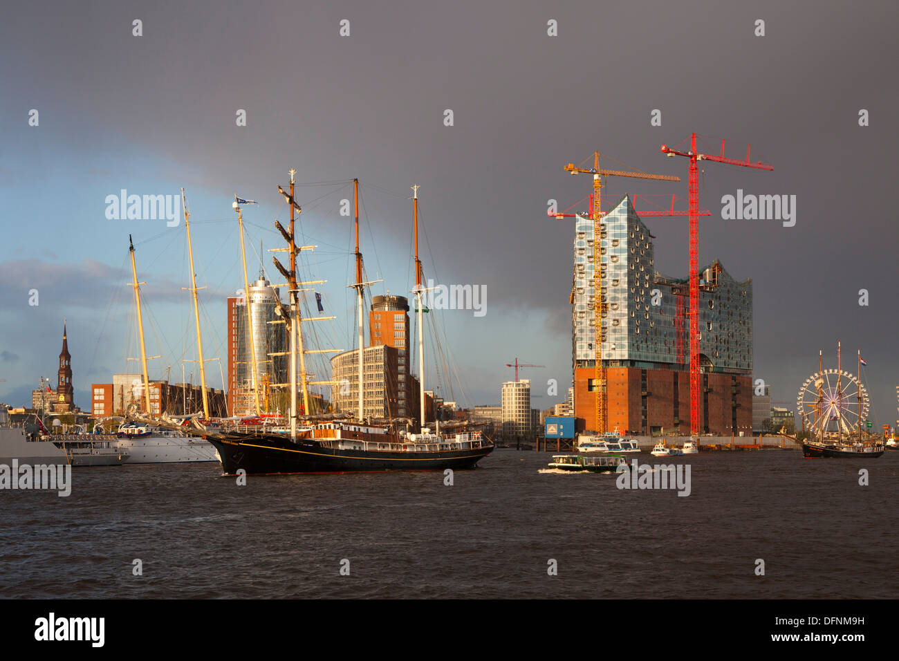 Sailing ship in front of Hafen City and Elbphilharmonie, Hamburg, Germany, Europe - Stock Image