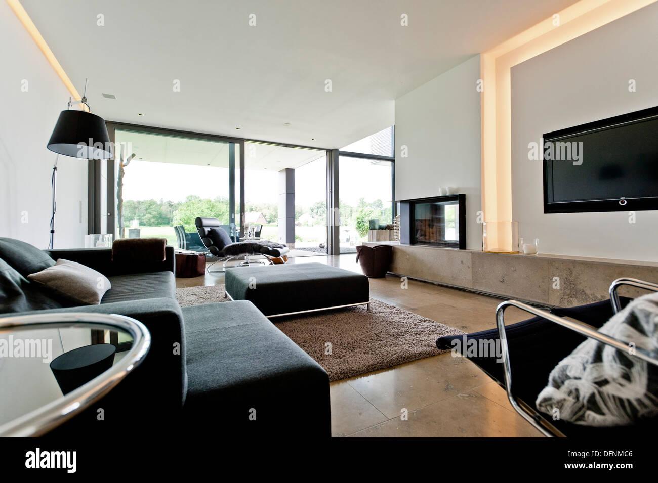 Open-plan living area, Neuenkirchen, North Rhine-Westphalia, Germany - Stock Image