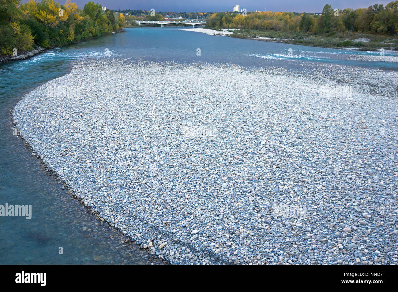 Newly deposited rocks and gravel from June 2013 flood of the Bow River. - Stock Image