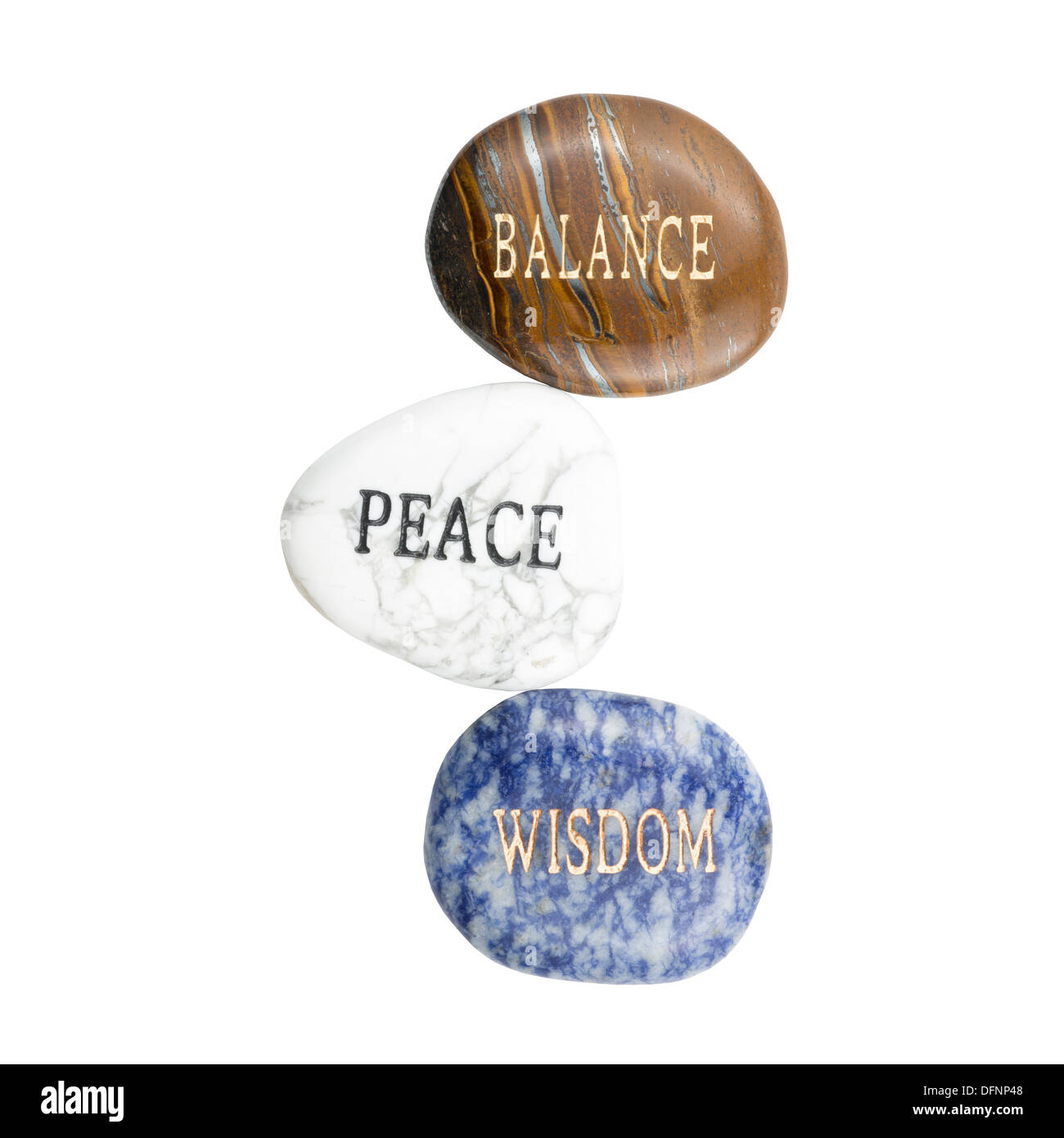 Stones with the words Balance (Polished Tiger Iron), Peace (Howlite), and Wisdom (sodalite). - Stock Image
