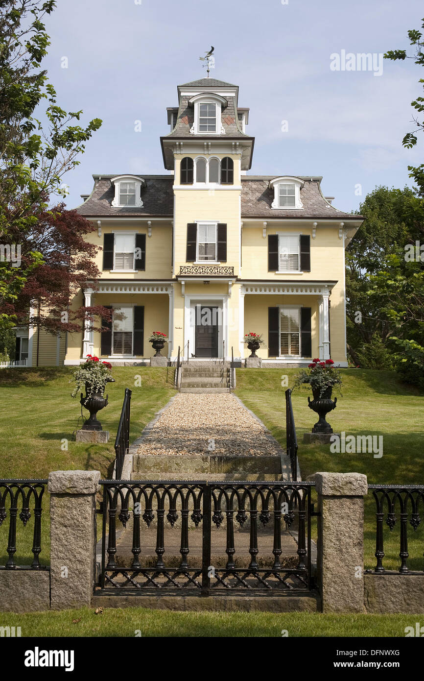 Residence with symmetrical mansard roofs (Victorian period), Pleasant Street, Rockport, Cape Ann, Massachusetts, USA - Stock Image
