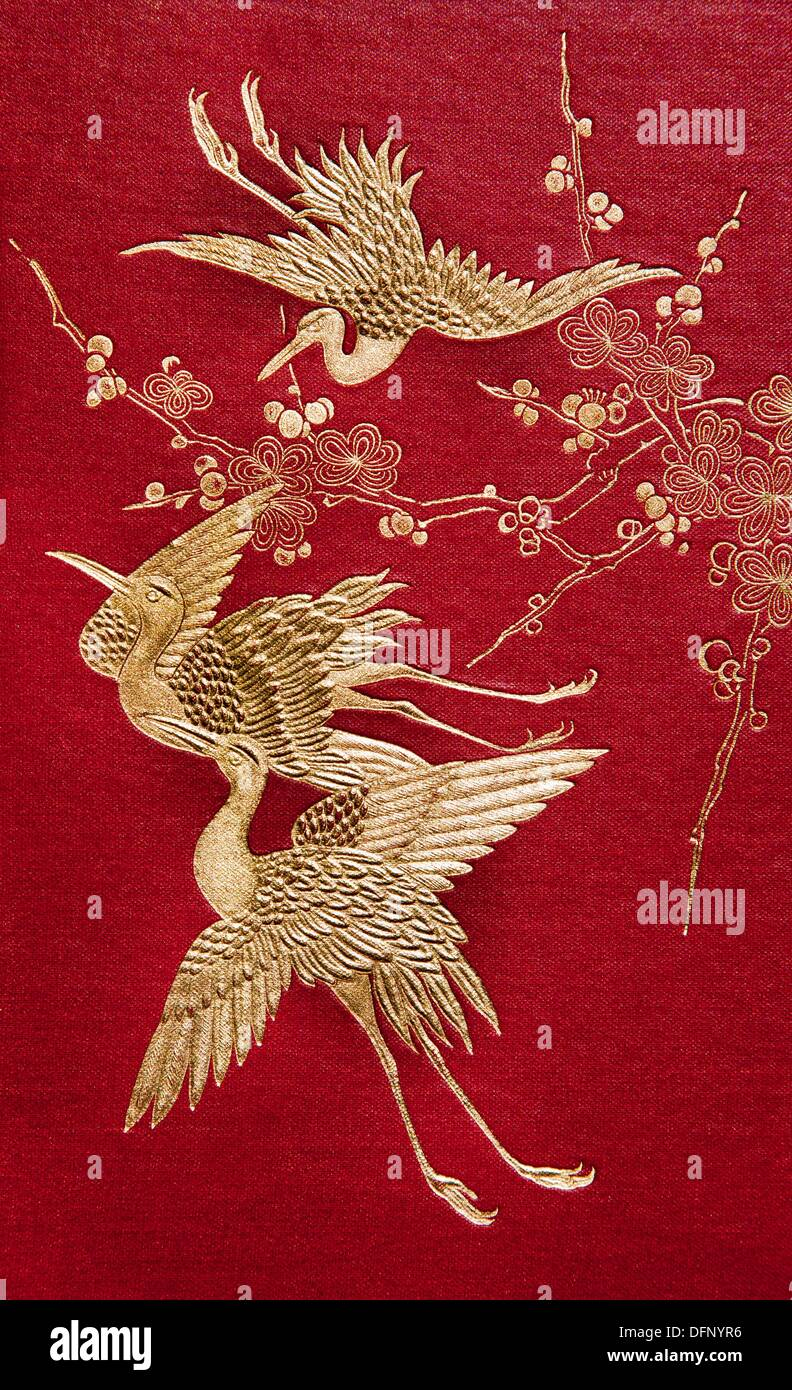 Embossed Japanese cranes on cover of 2 volume book ´ Japan and her people´ by Anna Hartshorne, Philadelphia, 1902 - Stock Image