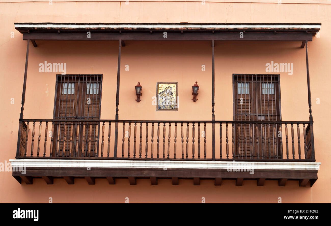 Wooden second floor balcony two doors Virgin Mary and Jesus painting on wall exterior & Puerto Rico San Juan. Wooden second floor balcony two doors ...