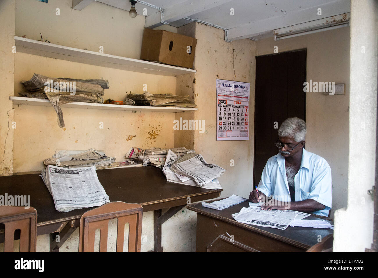 Man working in Betting office bookies in Galle Sri Lanka - Stock Image