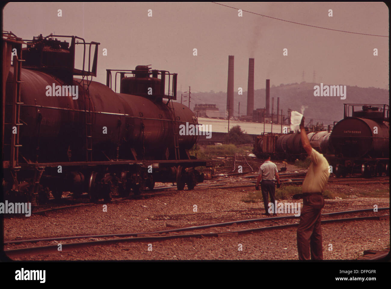 RAILROAD YARD AT NITRO WITH SMOKESTACKS OF THE FMC CHEMICAL CORPORATION IN BACKGROUND 551006 - Stock Image