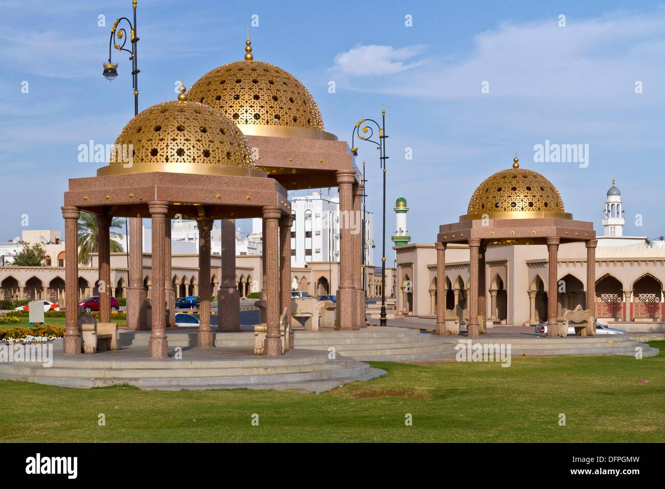 Golden domed cupolas on the harbourfront of Muscat, Oman. - Stock Image