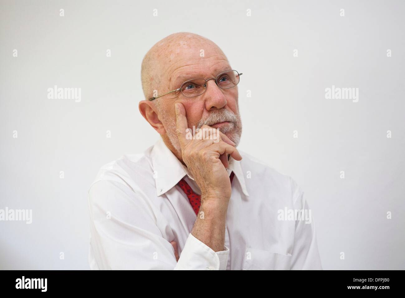 Man lost in his thoughts - Stock Image