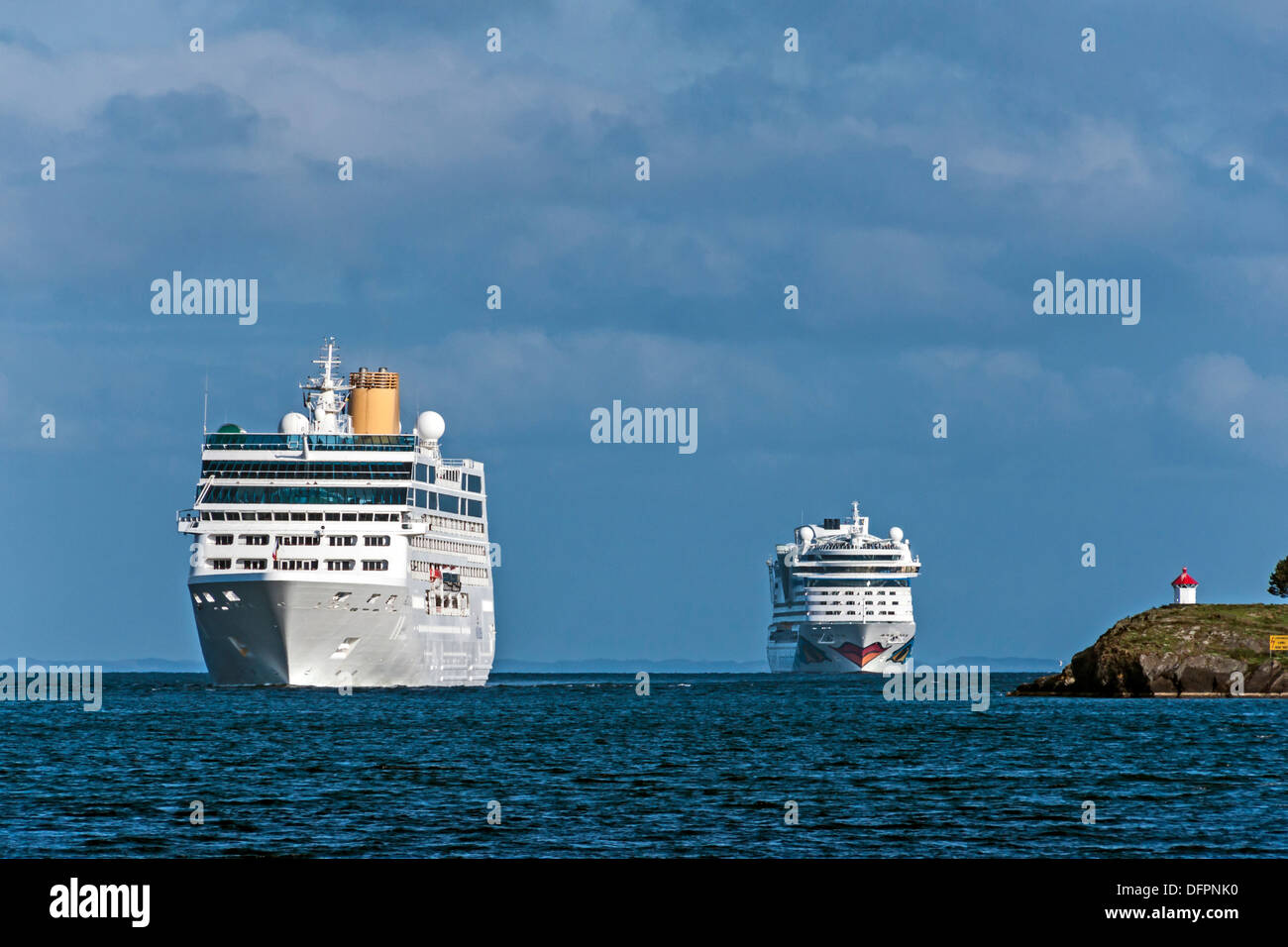 Entrance to Stavanger Harbour Norway with cruise ships Adonia left and Aida approaching Stock Photo
