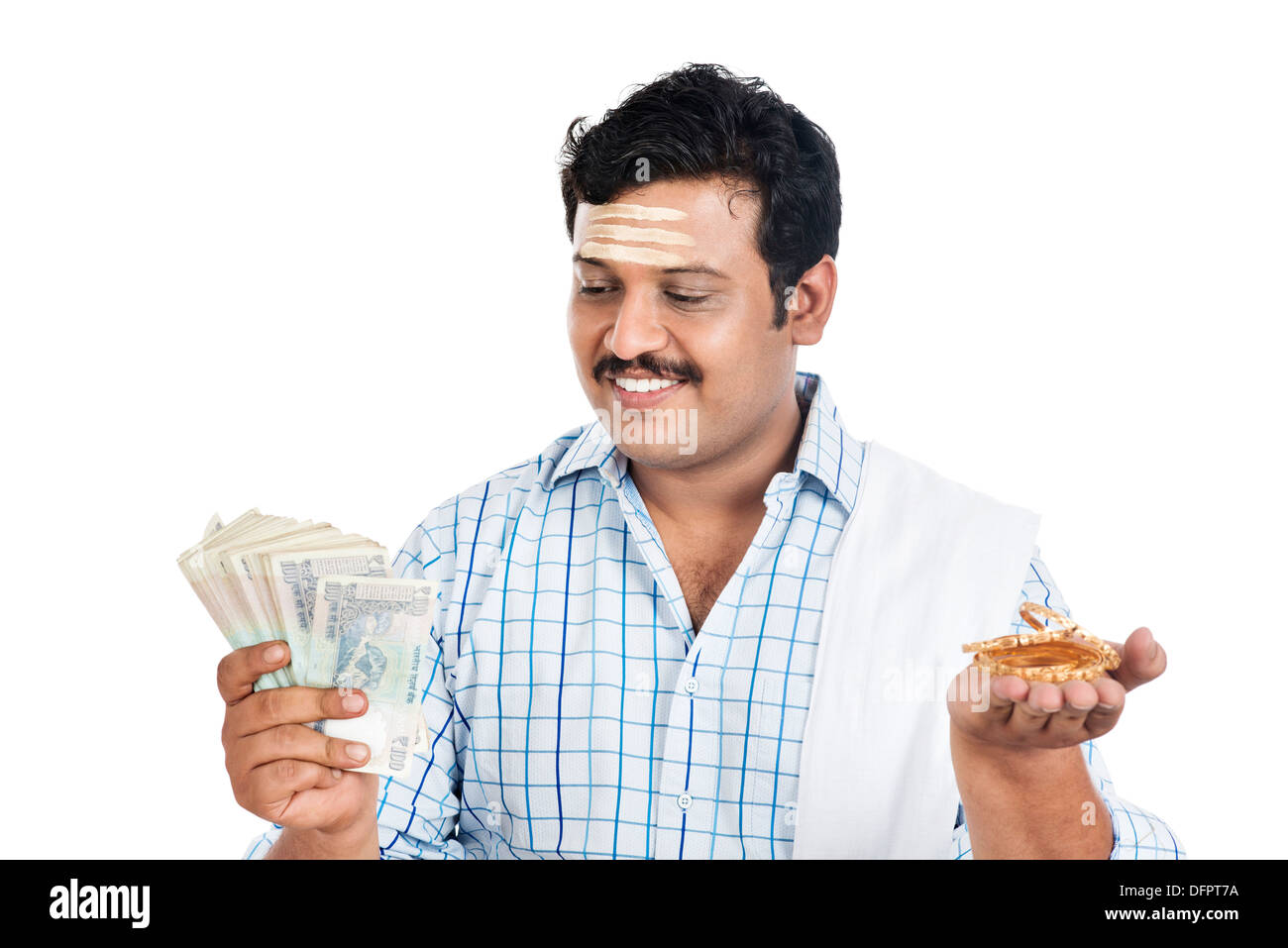 South Indian man holding money and gold bangle - Stock Image