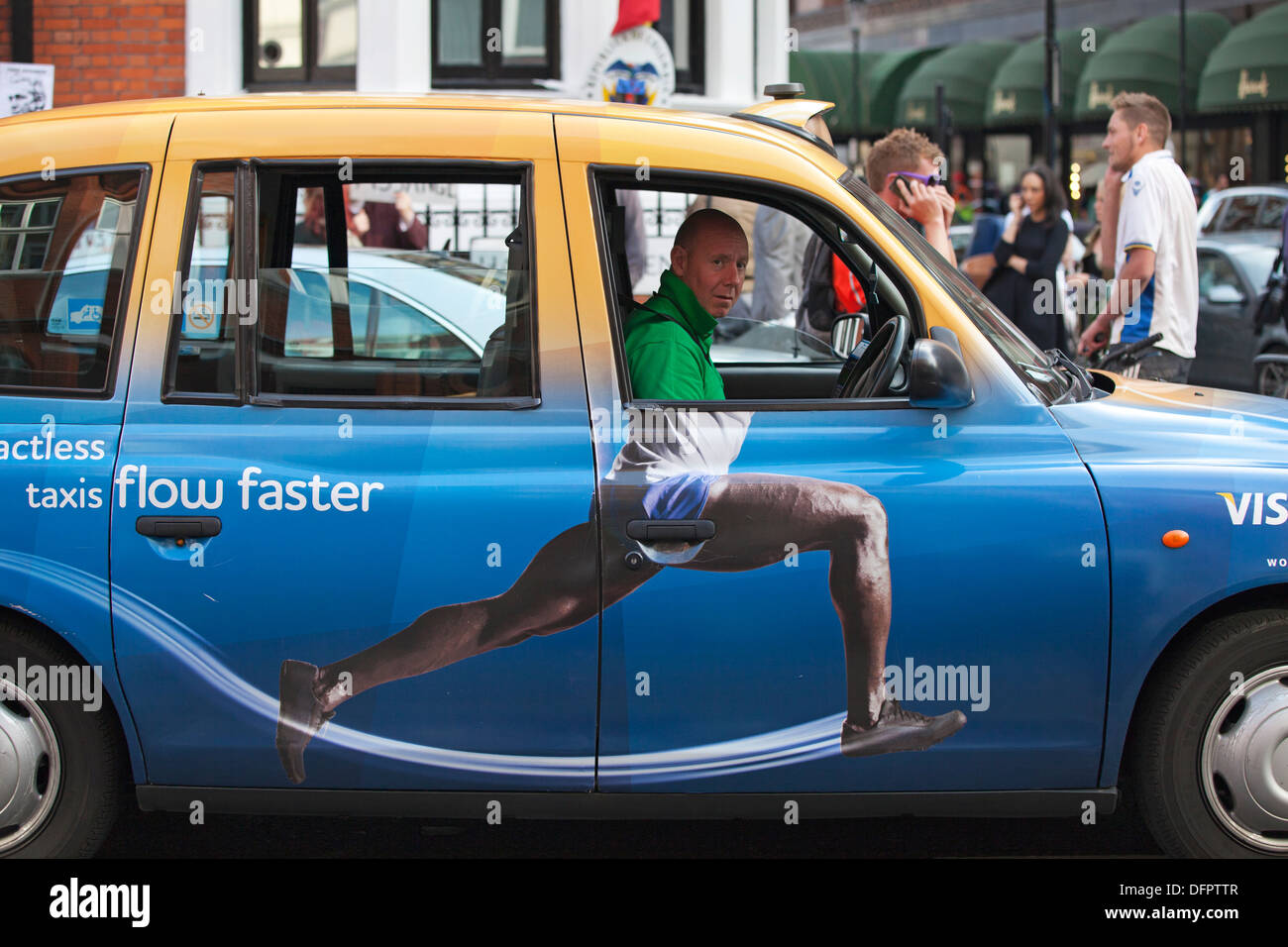 Hackney cab with Barclays advertisement on the side, London, UK - Stock Image