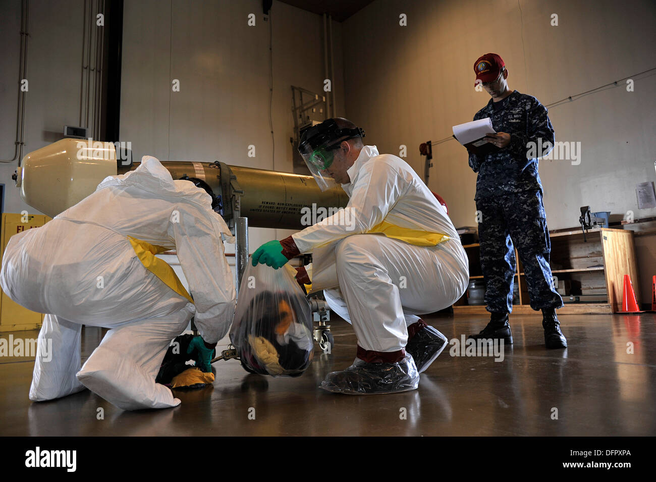 MISAWA AIR BASE, Japan (Sept. 26, 2013) Damage Controlman 2nd Class Jerrett Hurtt, left, originally from Humboldt, Ariz., and Av - Stock Image