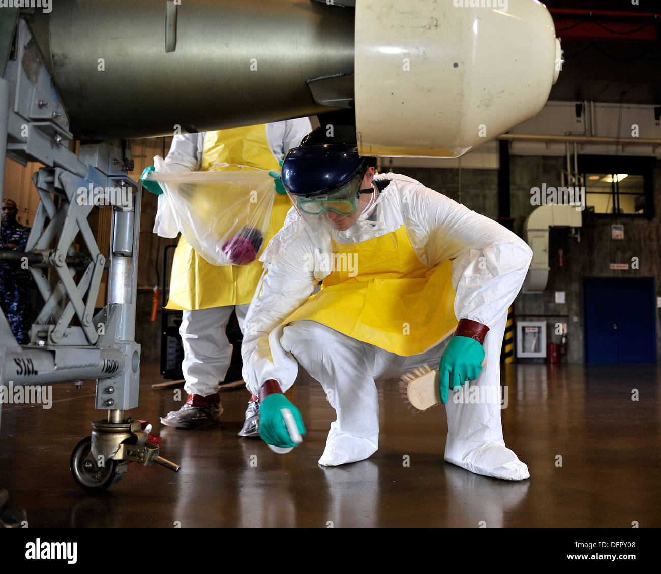 MISAWA AIR BASE, Japan (Sept. 26, 2013) Damage Controlman 2nd Class Jerrett Hurtt, originally from Humboldt, Ariz., cleans up a - Stock Image