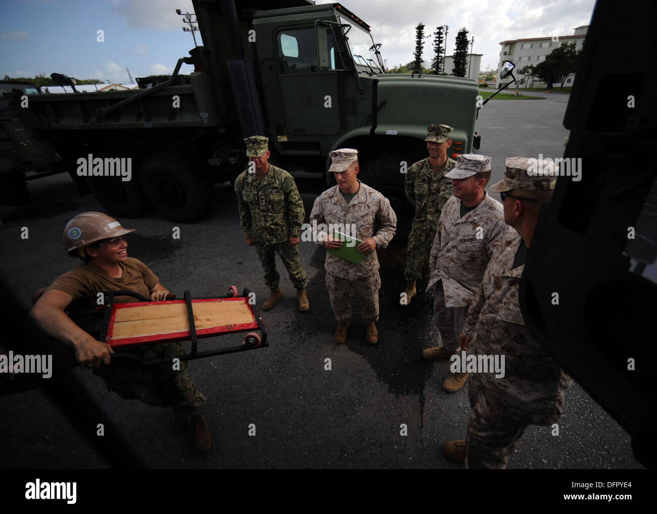 Equipment Operator Constructionman Nicole Cusson, front, assigned to Naval Mobile Construction Battalion (NMCB) 3, performs a ve - Stock Image