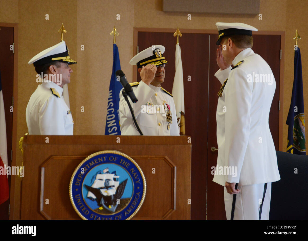 Rear Adm. Vic Beck, center, is relieved by Capt. Kent Davis as the Vice Chief of Information during his retirement ceremony in the Sail Loft at the Washington Navy Yard. - Stock Image