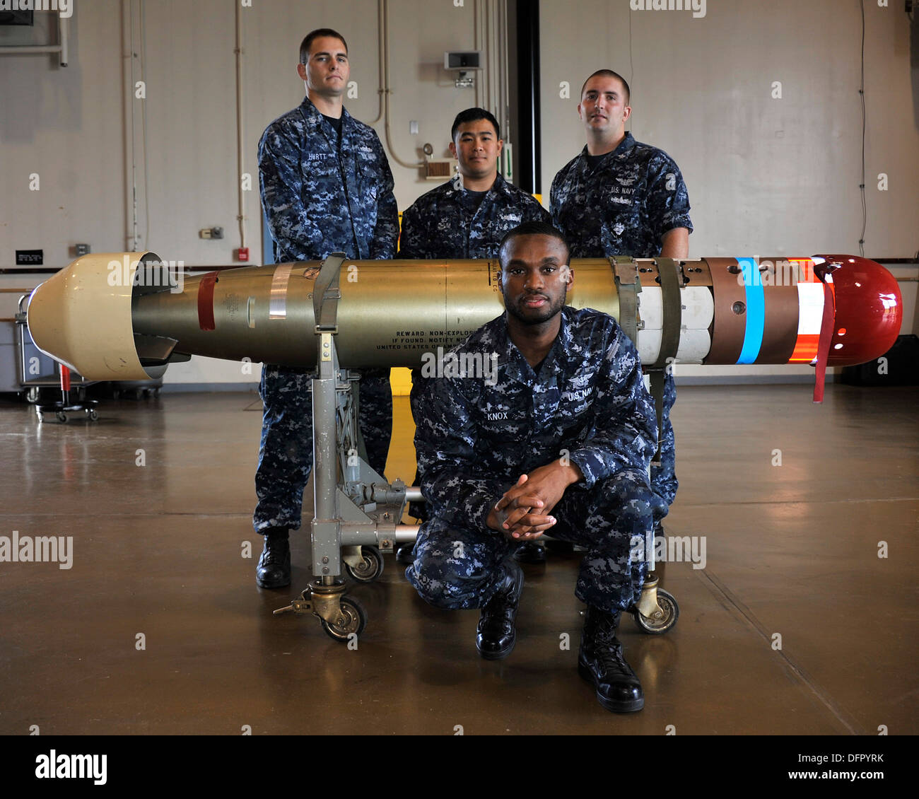 MISAWA AIR BASE, Japan (Sept. 26, 2013) From left, Damage Controlman 2nd Class Jerrett Hurtt, originally from Humboldt, Ariz.; G - Stock Image