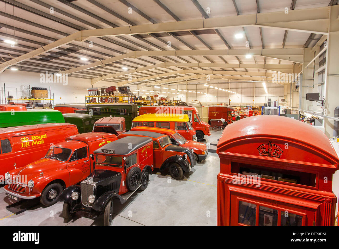 A view of the British Postal Museum Store in Debden. Alongside the historic telephone kiosks a number of vehicles can be seen, including the Morris Eight hybrid van from 1938, and a 1961 Morris Minor Van, - Stock Image