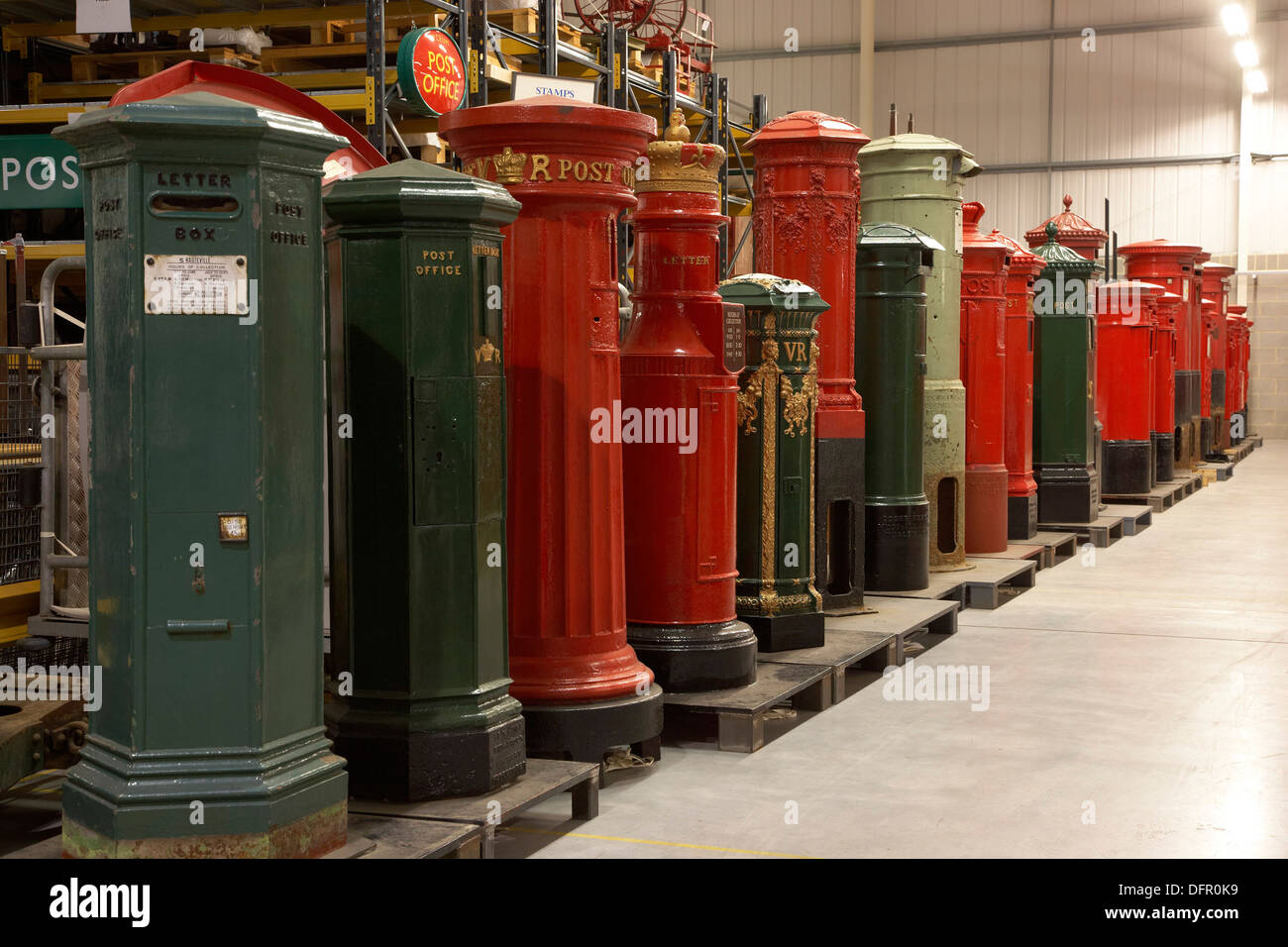 the british postal museum store at debden near loughton essex the line of pillar boxes show the development of post boxes