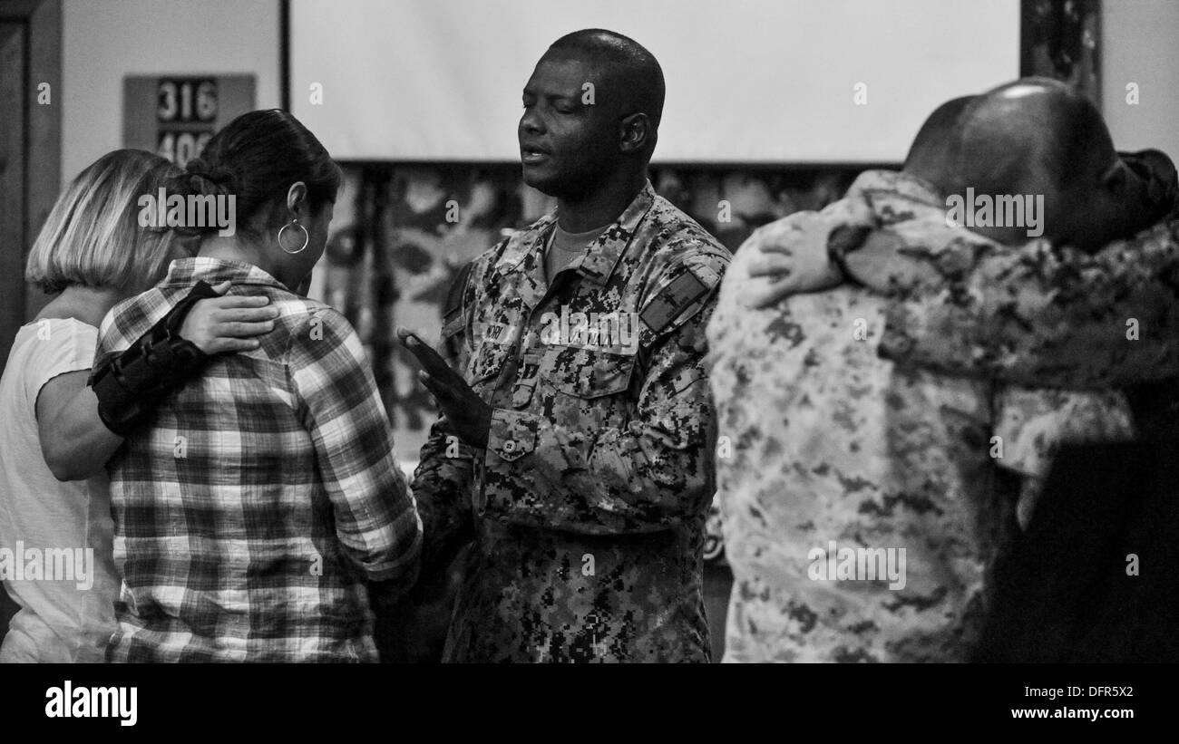 Camp Lemonnier and Combined Joint Task Force - Horn of Africa chaplains comfort service members during religious services at the camp chapel. The service was part of the Camp Lemonnier Revival, featuring eight days of Christian worship. - Stock Image