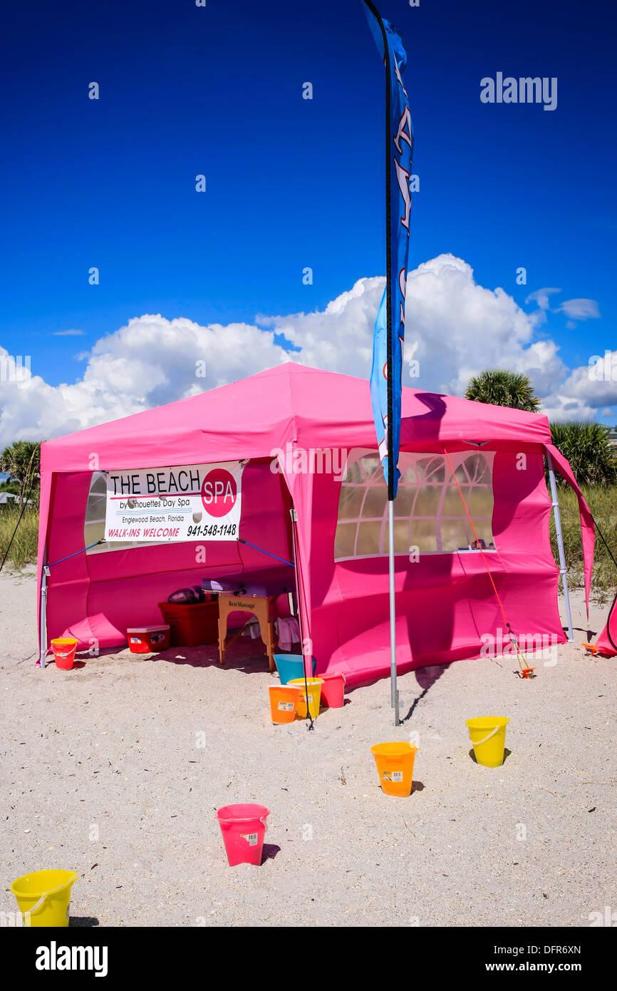 Massage tent on a sun kissed Florida beach - Stock Image