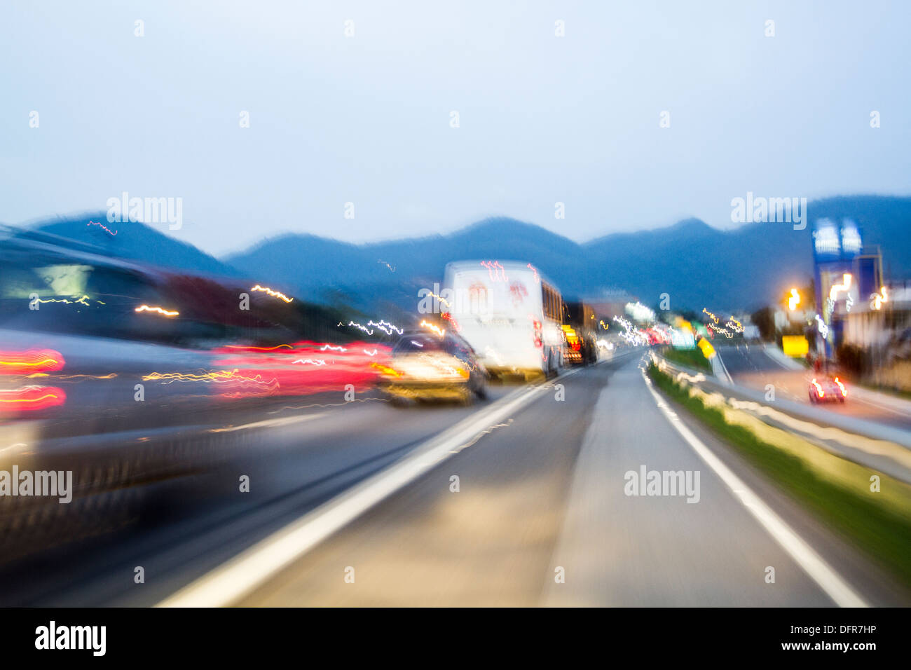 Blurred motion on a road at evening. - Stock Image