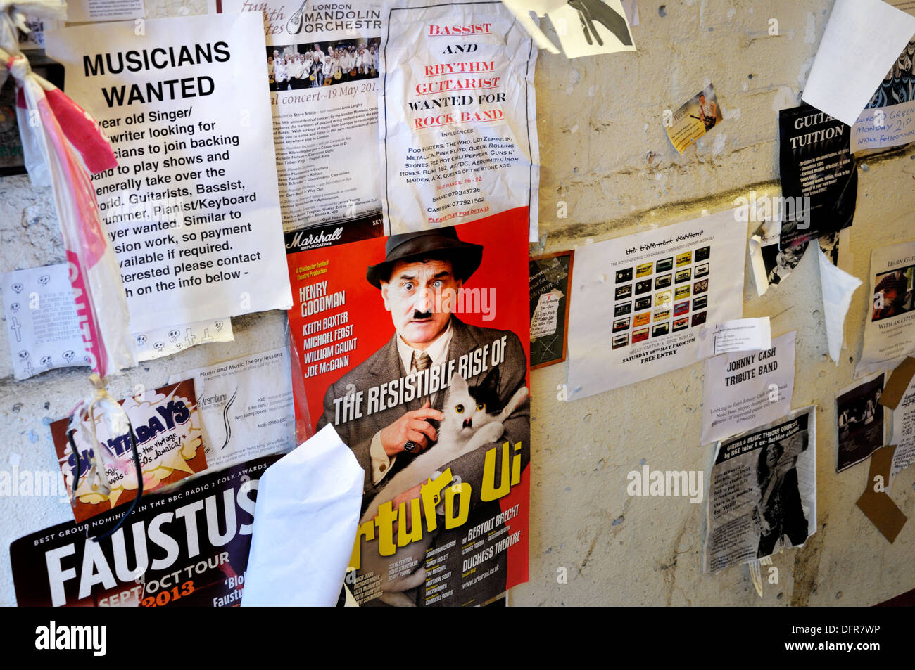 London, England, UK. Posters and adverts stuck to a wall (legible contact details changed or obscured) - Stock Image