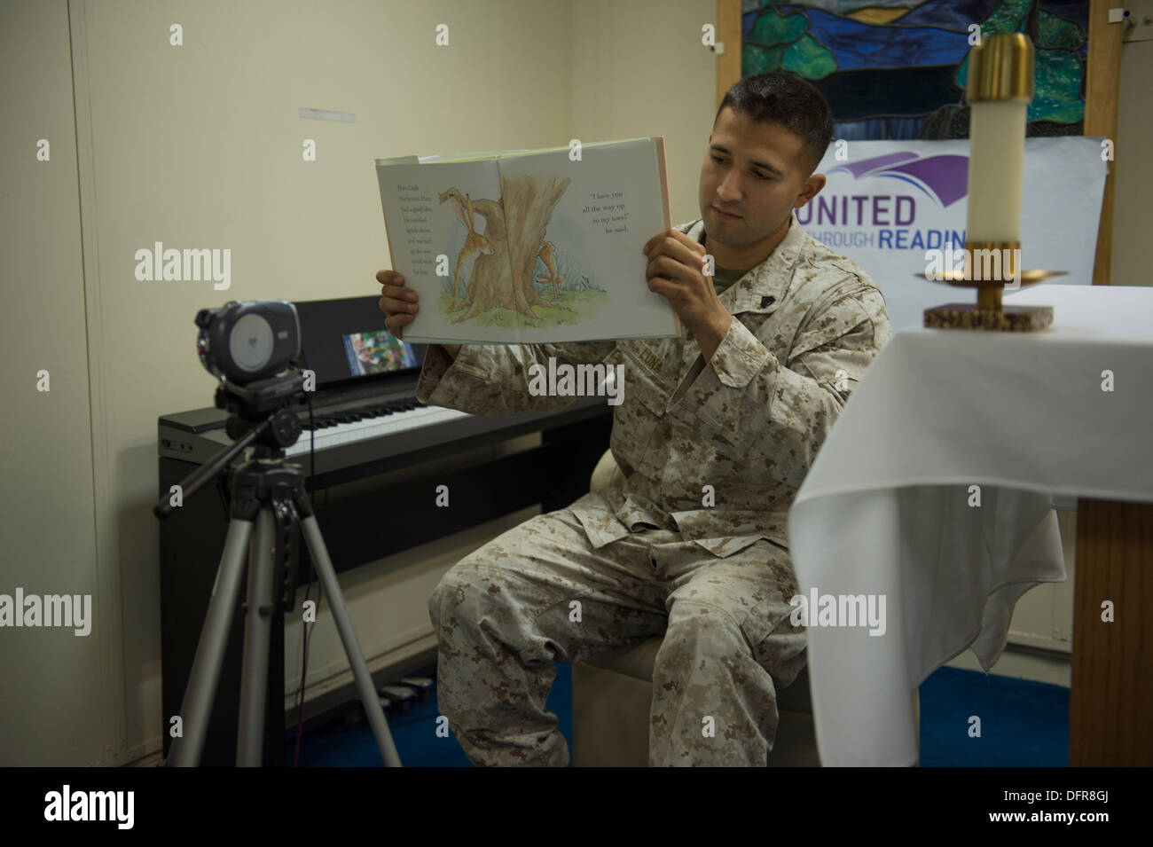 SOUTH CHINA SEA (Sept. 28, 2013) Sgt. Marcos Luna records himself reading a children's book as part of the United Through Readi - Stock Image