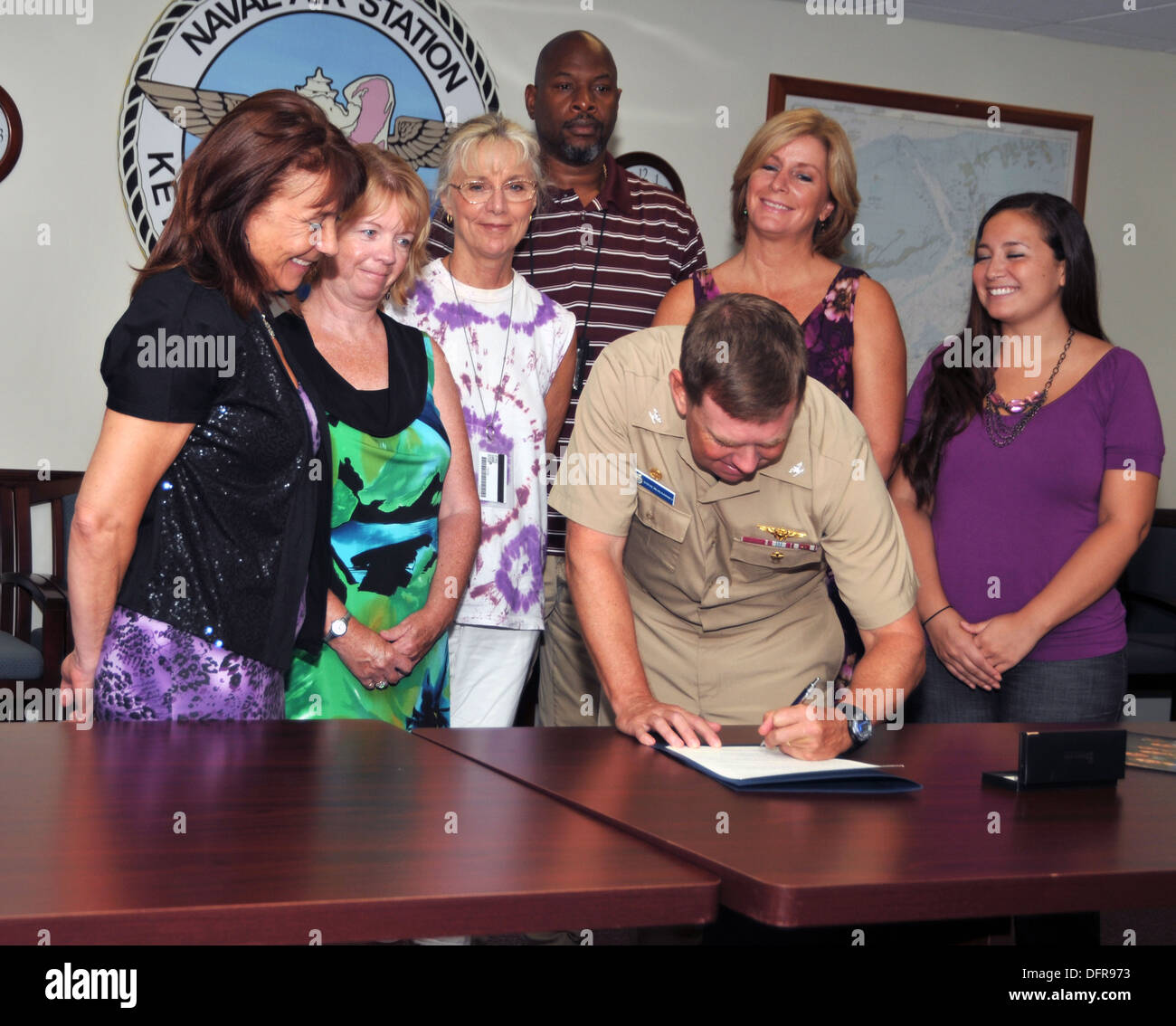 Naval Air Station (NAS) Key West Commanding Officer Capt. Steve McAlearney signs the proclamation of domestic violence awarenes - Stock Image