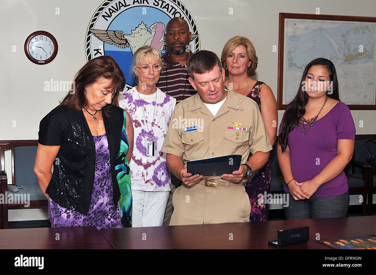 Naval Air Station (NAS) Key West Commanding Officer Capt. Steve McAlearney reads the proclamation of domestic violence awareness month at Boca Chica Field. NAS Key West is a state-of-the-art training facility for air-to-air combat fighter aircraft of all - Stock Image
