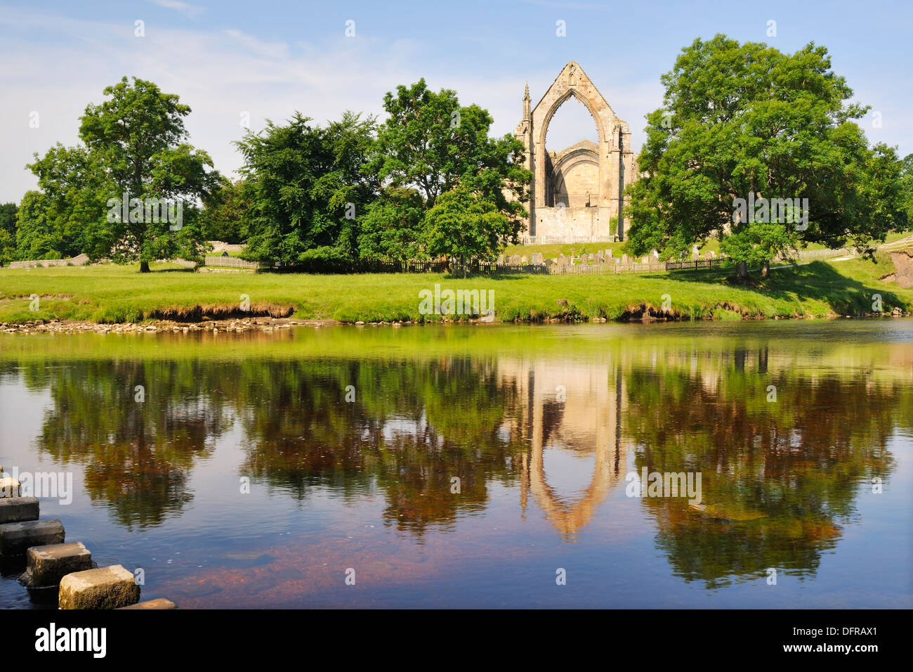 The ruins of Bolton Priory reflected in the River Wharfe, Bolton Abbey, Yorkshire Dales National Park, England Stock Photo