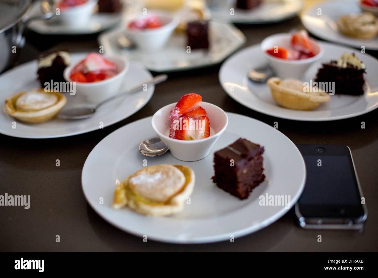 trio of deserts strawberries apple pie chocolate cake - Stock Image