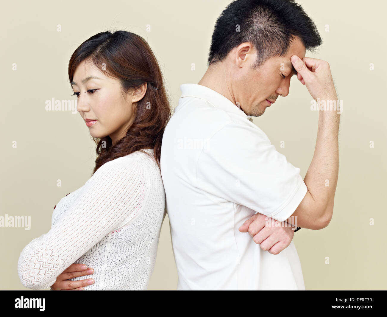 Sad Asian Couple - Stock Image